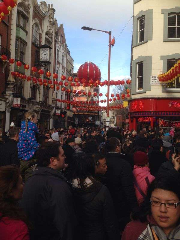Chinese Lanterns above Chinese New Year crowd - chinatown